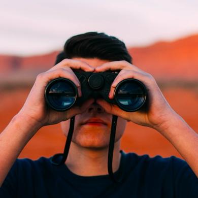 Photo of a person using binocular